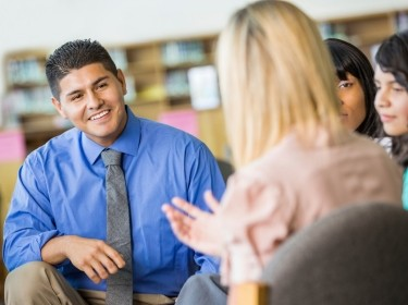 Principal in group discussion with students