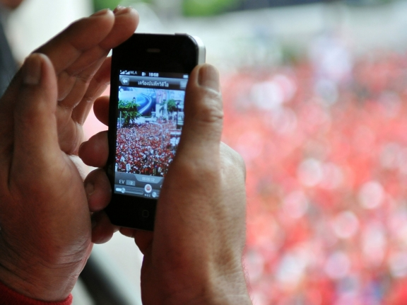 A smartphone is used to photograph a Red Shirt rally in Bangkok, Thailand, photo by Akabei/iStock