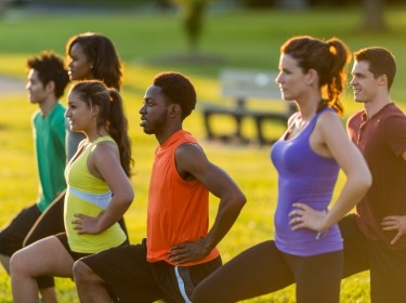 Diverse group of adults in an outdoor fitness class