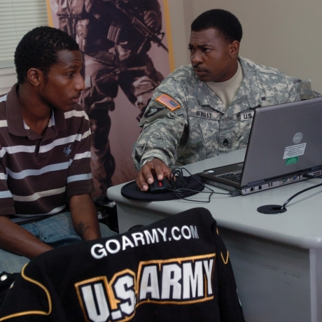 Staff Sgt. Roger L. Whaley speaks with a candidate at the U.S. Army Recruiting Station in Radcliff, Ky., photo by Sgt. Carl N. Hudson/U.S. Army
