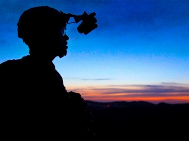 A U.S. soldier provides overwatch security atop a mountain at Paktika province, Afghanistan, May 25, 2011
