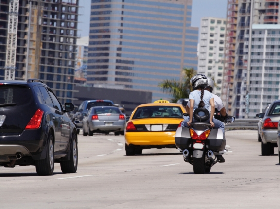 Motorcycle and cars on a highway, photo by felixmizioznikov/iStock
