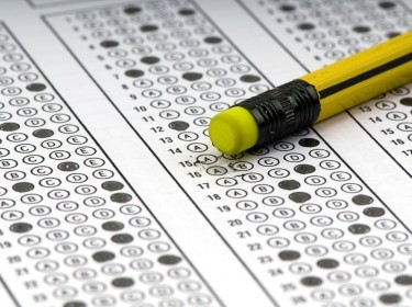 A multiple-choice examination sheet and a pencil eraser
