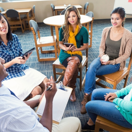 College students in a group therapy session, photo by Steve Debenport/iStock