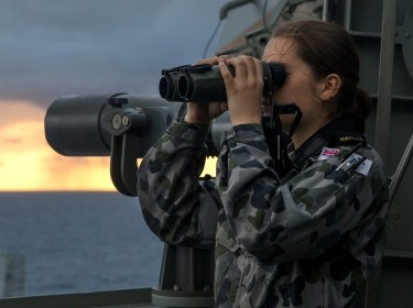 Midshipman Rachel Bolitho looks out from the bridge wing of HMAS Canberra during Sea Series 2015