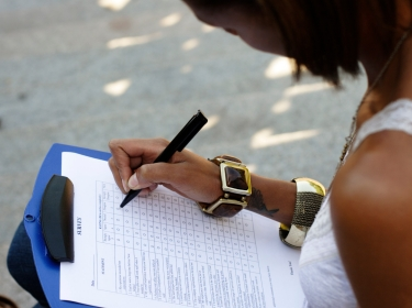 Woman filling out a survey