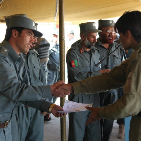 An Afghan Local Police recruit receives his certificate of completion on graduation day in Ghazni province, Afghanistan, September 26, 2013, photo by Spc. Jessica Reyna DeBooy/U.S. Army