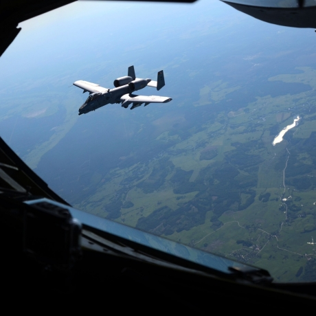 An A-10C Thunderbolt II flies near a KC-135 Stratotanker after departing from Amari Air Base, Estonia, during an exercise with the Estonian Air Force and Maryland Air National Guard, June 3, 2013, photo by SSgt. Benjamin Hughes/U.S. Air National Guard
