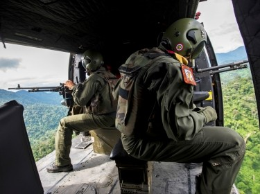 Venezuelan soldiers patrol during a military operation to destroy clandestine drug laboratories in Zulia, Venezuela, near the border with Colombia, December 6, 2014