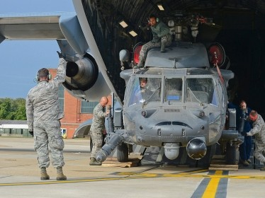 Airmen from the 748th Aircraft Maintenance Squadron offload one of the two HH-60G Pave Hawk helicopters from a C-17 Globemaster III at Royal Air Force Mildenhall, United Kingdom, Sept. 19, 2013