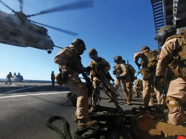 U.S. Marines storm aboard MSC dry cargo/ammunition ship USNS Laramie during a visit, board, search, and seizure exercise