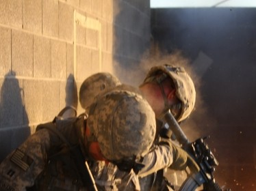 Soldiers particpate in an urban combat exercise