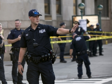 Police investigate the scene of a shooting at a federal office building in Lower Manhattan, New York, August 21, 2015