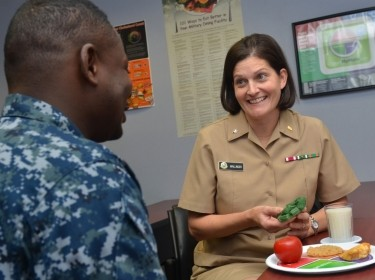 Cmdr. Jennifer Wallinger, a dietitian at Naval Hospital Jacksonville, recommends healthy food and beverage choices to a patient, December 9, 2016