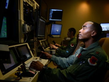Maj. Bishane, a 432nd Aircraft Maintenance Squadron MQ-9 Reaper pilot, controls an aircraft from Creech Air Force Base, Nevada