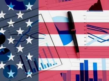 Composite image of U.S. flag with graphs and a pen