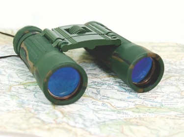 Binoculars on a map, photo by Angel_a/Getty Images
