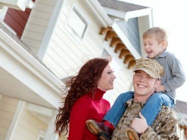 A U.S. Marine Corps soldier and his family outside their home