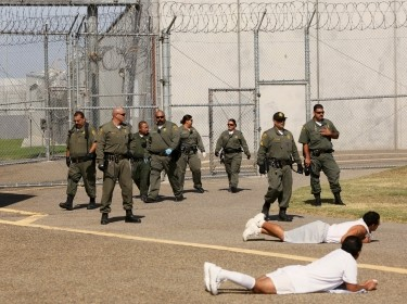 Guards move into the exercise yard near a general population cell block at Corcoran State Prison, California, October 1, 2013