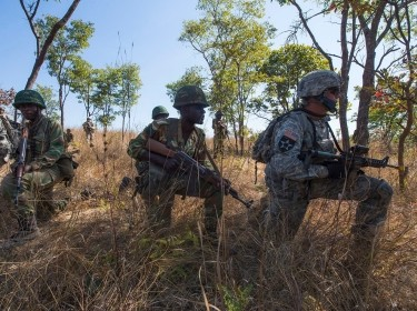 U.S. Army soldiers and members from the Zambian Defense Force work together during a daytime tactical movement at exercise Southern Accord 15 in Lusaka, Zambia, August 5, 2015