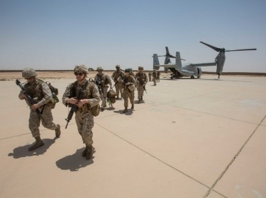 Marines unload from an MV-22B Osprey at Al Asad Air Base, Iraq, June 4, 2018