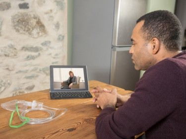 Patient consulting with his doctor via videochat over his laptop, photo by Henfaes/Getty Images