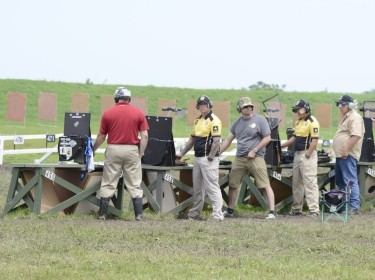 Competitors prepare to fire during the 2015 Civilian Marksmanship Program National Trophy Pistol Matches in Camp Perry, Ohio, photo by Sgt. 1st Class Raymond J. Piper/U.S. Army