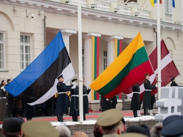 Flags of Estonia, Lithuania, and Latvia are raised in a ceremony outside the presidential palace in Vilnius, Lithuania, during the country's centenary celebration, February 16, 2018, photo by Birute/Getty Images