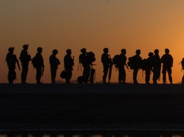 U.S. Army soldiers wait to board a C-17 Globemaster III aircraft at Joint Base Balad, Iraq, on Nov. 17, 2008.  The aircraft is deployed from the 437th Airlift Wing out of Charleston Air Force Base, S.C.