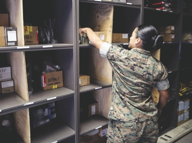 Sgt. Angie Novoa, a warehouse chief with Special Purpose Marine Air-Ground Task Force Crisis Response-Africa, organizes a shelf in her warehouse on Naval Air Station Sigonella, Italy, Oct. 28, 2016, photo by Cpl. Alexander Mitchell/U.S. Marine Corps