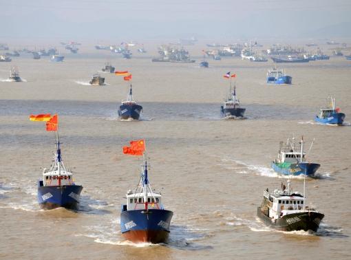 Fishing boats departing from Shenjiawan port in Zhoushan, Zhejiang province towards the East China Sea fishing grounds, September 17, 2012, photo by Stringer/Reuters