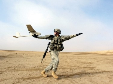 A solider using an RQ-11B Raven, a small hand-launched remote-controlled unmanned aerial vehicle, in 2006, photo by SFC Michael Guillory/U.S. Army