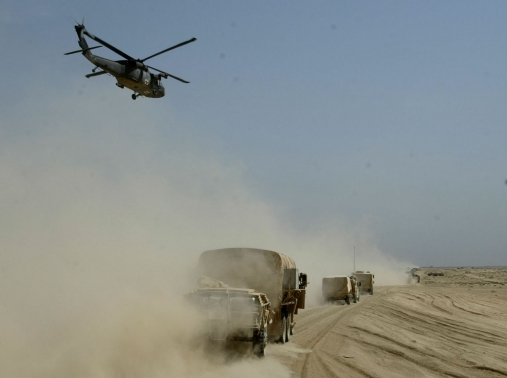 A U.S. Army medical helicopter flies over a convoy on its push towards Baghdad, Iraq, April 3, 2003