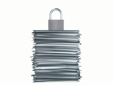 Graphic of lock on top of a stack of documents, photo by Rustem GURLER/iStock