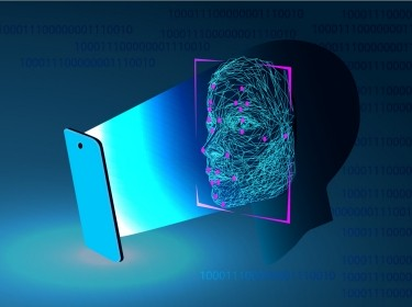 Facial recognition on a mobile device, image by Irina Shi/Adobe Stock