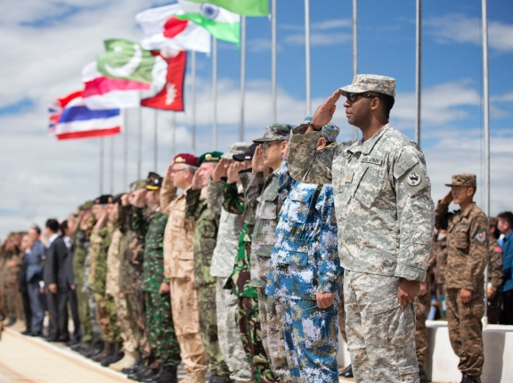 Service members from participating nations salute during the opening ceremony of Khaan Quest 2014, a multinational exercise designed to promote regional peace and security. It is co-sponsored by U.S. Army Pacific and hosted annually by Mongolian Armed Forces, photo by Sgt. Edward Eagerton/U.S. Army