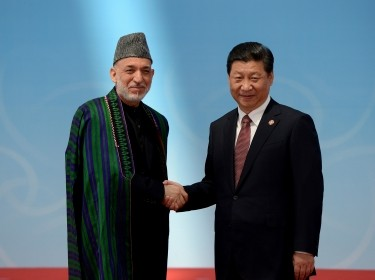 Afghanistan's President Hamid Karzai and his Chinese counterpart Xi Jinping shake hands before the opening ceremony of the fourth Conference on Interaction and Confidence Building Measures in Asia summit in Shanghai May 21, 2014