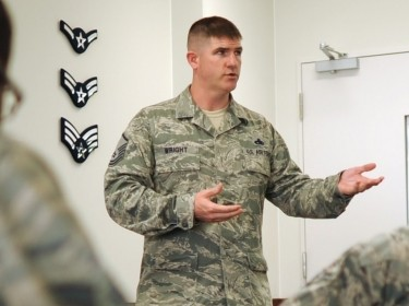 A master resiliency trainer for the 374th Airlift Wing talks to Airmen about resiliency at the First Term Airmen Center.