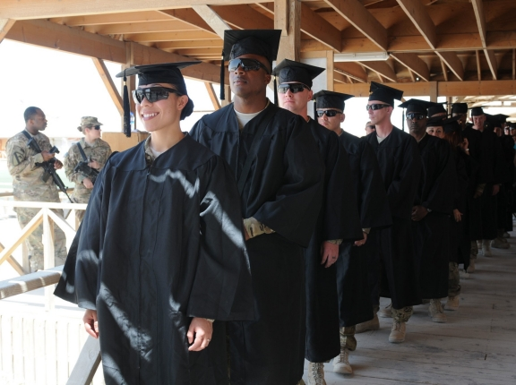 U.S. soldiers in line for the first-ever Kandahar Airfield college graduation ceremony, Afghanistan, May 23, 2012, photo by Sgt. Gregory Williams/U.S. Army