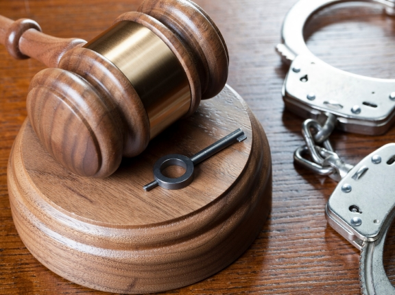 A gavel and handcuffs, photo by Oxford/iStock