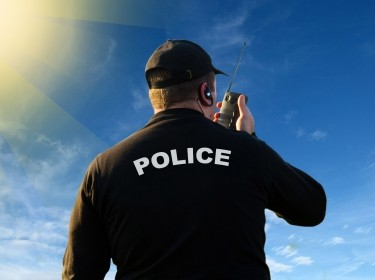 Police officer using a radio to communicate