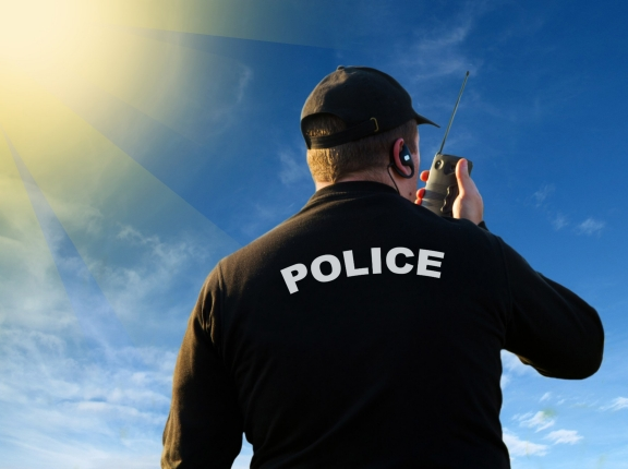 Police officer using radio to communicate, photo by Lsantilli/Fotolia