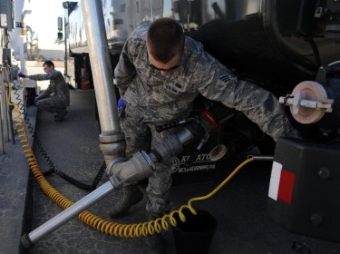 Senior Airmen Derek Wilson, foreground, and Noah Lazurka sample the fuel from a tank Feb. 11, 2015, at Seymour Johnson Air Force Base, N.C. Laboratory technicians test all fuel upon receipt, and at various other scheduled intervals. Wilson and Lazurka are both 4th Logistics Readiness Squadron fuels laboratory technicians