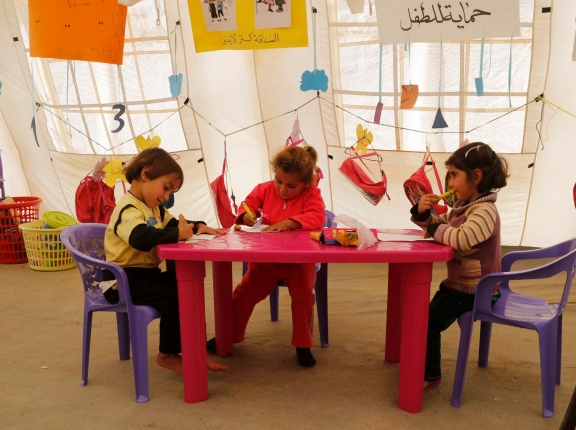 Syrian refugee children draw inside a makeshift school, supported by UNICEF and in cooperation with the Beyond Association, in Zahle, Lebanon, October 22, 2014, photo by Mohamed Azakir/Reuters