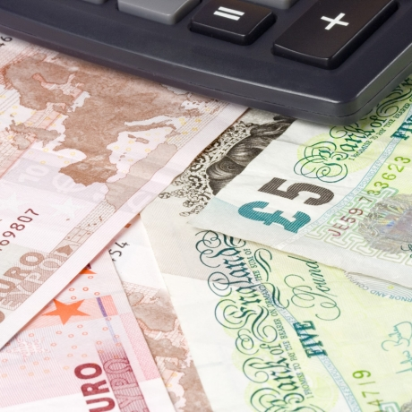 Forex - British and Euro currency pair with calculator, photo by Jonathan Lim Yong Hian/Fotolia