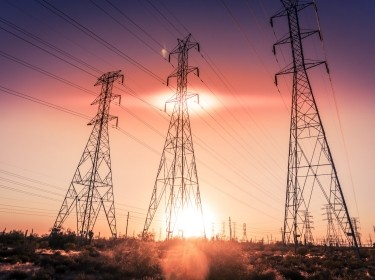 Electricity supply towers in sunset