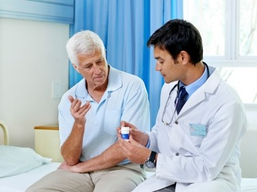 Doctor consulting wth patient