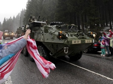 People welcome U.S. Army soldiers during a military exercise in Harrachov, Czech Republic