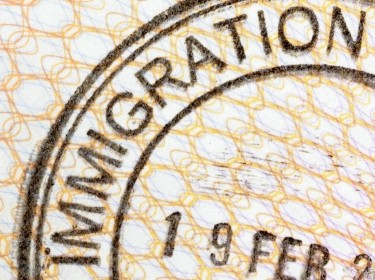 Immigration entry stamp on the inside page of a passport