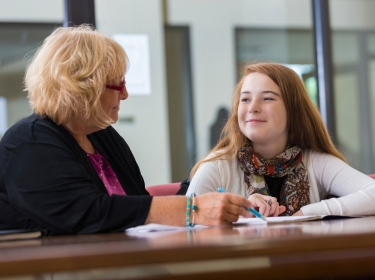 A student meets with a school counselor